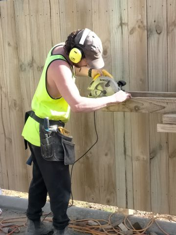 Joe Cutting Timber for the Retaining Wall